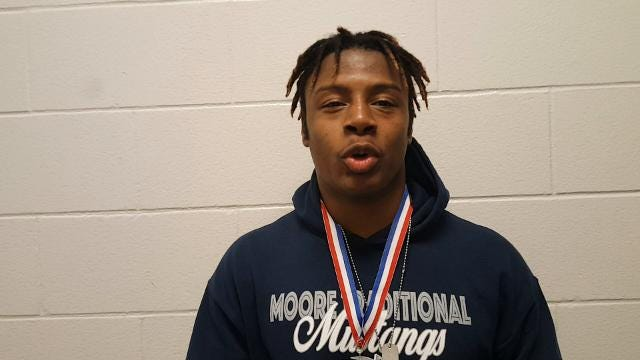 Moore's Damoreon Travis was voted the Most Outstanding Wrestler of Saturday's Region Four Wrestling Championships.