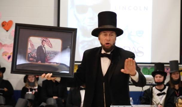 The Lincoln Performing Arts School goes after Guinness World Record by having the most people dressed as Abraham Lincoln at one time.