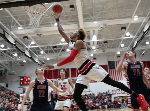Langford had 25 points and East scored 30 points as the Bulldogs routed Bedford North Lawrence with Damon Bailey watching from the sidelines.
