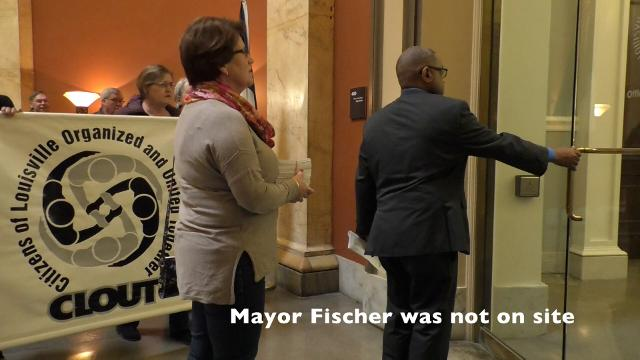 CLOUT (Citizens of Louisville Organized and United Together) members rallied Thursday to deliver petitions in favor of de-escalation tactics to Louisville Mayor Greg Fischer's office. They were unable to meet in-person with the mayor. 4/19/2018