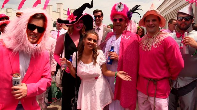From cowboy boots to the Wizard of Oz, everything is pink at Churchill Downs on Oaks day.