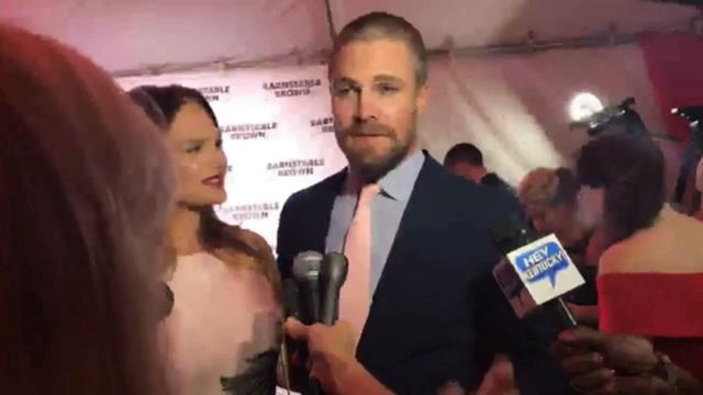 Amell and his wife, Cassandra, chatted with media on the red carpet at the gala.