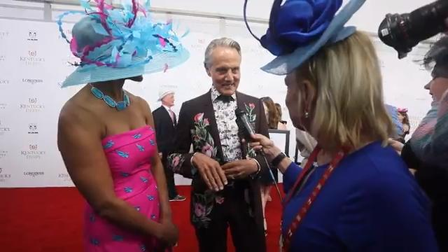 Monte Durham, of TV's 'Say Yes to the Dress: Atlanta,' was joined on the red carpet by Stacey Robinson with Kentucky Derby Festival.