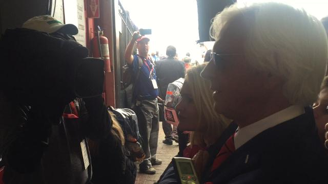 Justify trainer Bob Baffert watches the final seconds of the Preakness on Saturday in Baltimore.