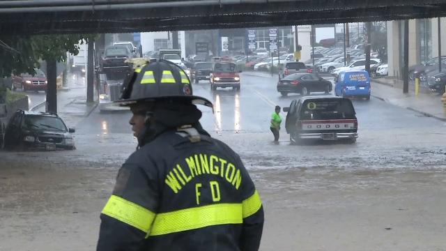 An afternoon storm flooded Pennsylvania Avenue and Union Street in Wilmington, leaving cars stranded in high water.