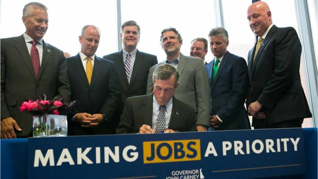 Gov. John Carney signed a bill Monday thatreplaces the Delaware Economic Development Office with a public-private partnershippartially run by some of the state's largest companies.