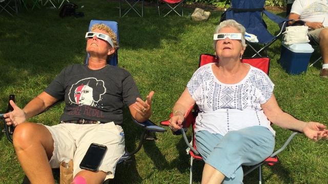 Jane Orescan, of Bear, left, and Barbara Greer, of Elkton, MD view the eclipse. The Delaware AeroSpace Education Foundation threw a free eclipse watching party and more than 1,000 people came.