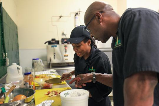 Culinary students at the Food Bank of Delaware's Culinary School cook from a set of mystery box ingredients as part of a food final before heading off for internships and jobs in the field