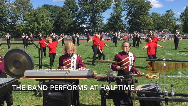 Volunteers help local high school marching bands get on and off football field quickly at halftime