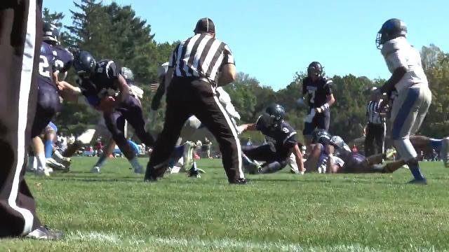Payne pushes the ball into the endzone for Friends