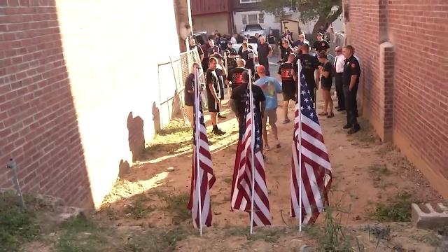 Three flags were planted Sunday morning at a now-demolished row home to mark the one-year- anniversary of the death of three Wilmington firefighters.  9/25/17