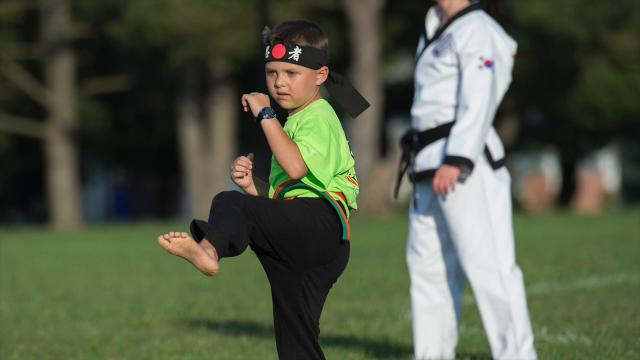 Second-grader Von Kleiv, 7, performs during a karate demonstration at the Laps for Lymphoma 2 fundraiser at Major George S. Welch Elementary School on Dover Air Force Base.