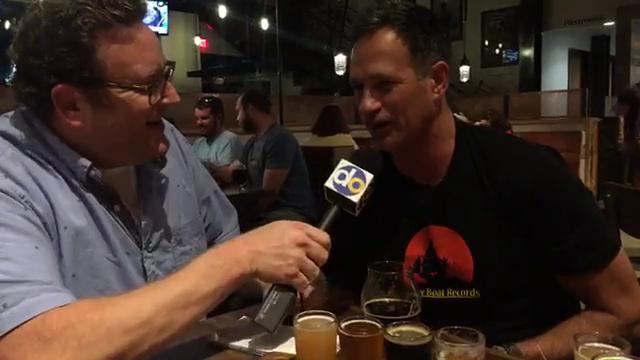 The News Journal entertainment writer  Ryan Cormier hosts a Facebook Live chat with Dogfish Head founder Sam Calagione at his bar and restaurant in Rehoboth Beach in 2017.
