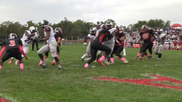 Hodgson's Darius Hale with a two point conversion run