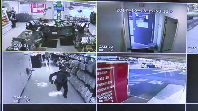 Surveillance footage shows police chasing suspect through store