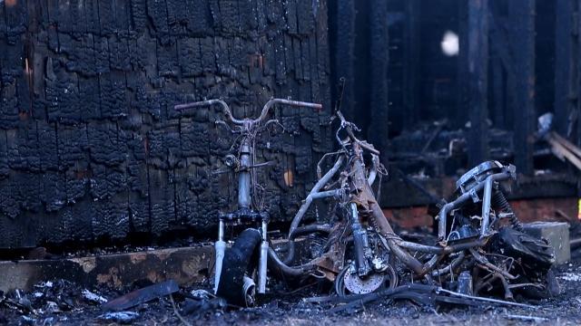 Neighbor runs to burning historic home