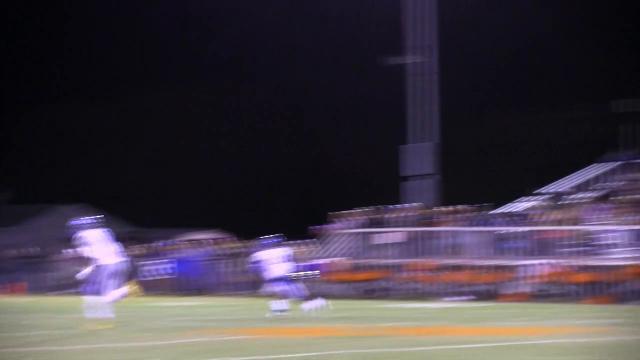 Woodbridge's Troy Haynes scrambles for a open receiver