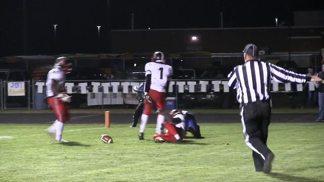 William Penn's Matthew Hibbert stops a touchdown attempt in the end zone