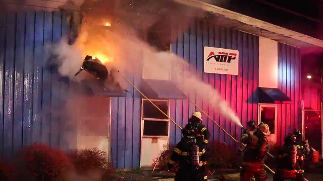 Firefighters needed more than an hour to get a fire at metal fabricator Amp Manufacturing on Hadco Road under control Thursday night. There were no reports of injuries.