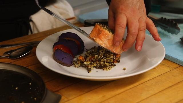 Movable Feast Executive Chef Lisa Scolaro prepares a furikake salmon dish for a popup dinner held at the restaurant.
