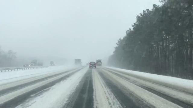 Raw Video: Motorists traverse snowy conditons