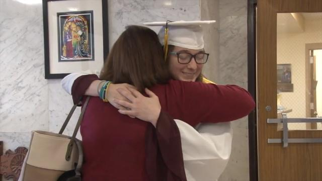 Former Padua student Kelly Muschiatti receives her diploma during a special ceremony in the school gym. Muschiatti suffered a traumatic brain injury in a 2016 crash. She plans to attend Appalachian State University following a rehabilitation program.