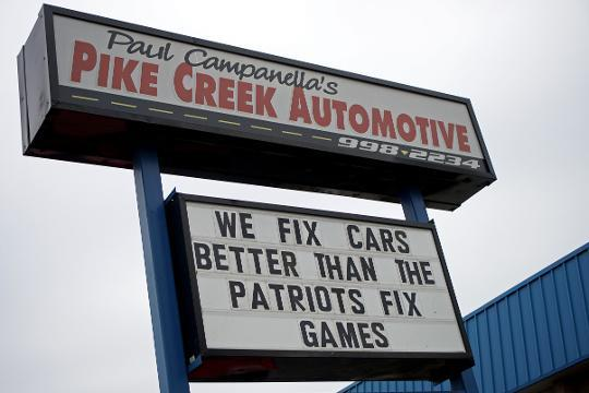 Auto repair workers use sign to celebrate Eagles pride