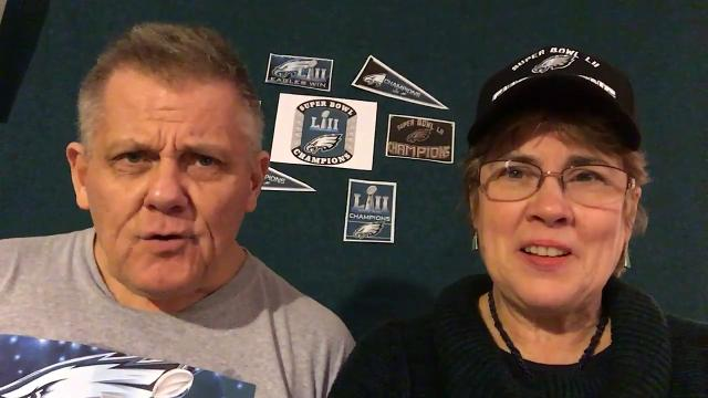 "Claymont resident Gerald Mousley and Holly Myers read ""A Victory with Saint Nick,"" a poem Mousely wrote about the Philadelphia Eagles' Super Bowl win inspired by ""The Night Before Christmas."""