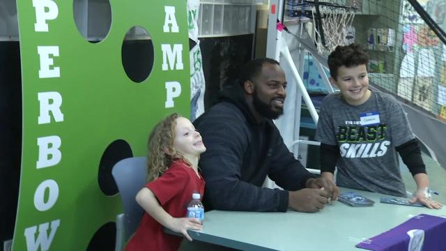 Eagles tackle visits A.I. du Pont Hospital to deliver check