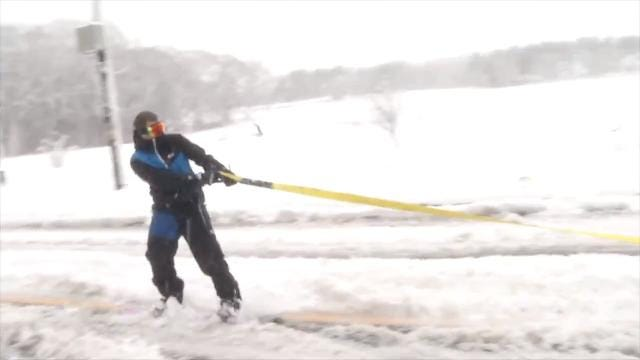 Raw Video: Snowboarder catches a ride from an SUV