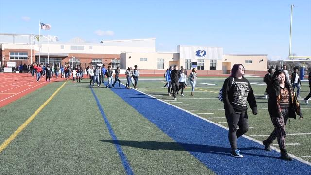 Dover High students walkout to remember victims