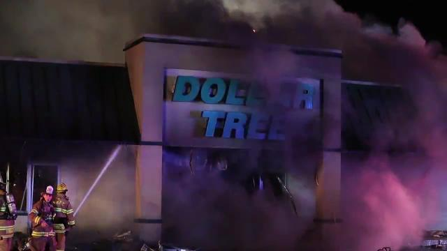 Firefighters work to contain a blaze that severely damaged a Dollar Tree store in Beaver Brook Plaza near New Castle, reported about 7:20 p.m. Friday.