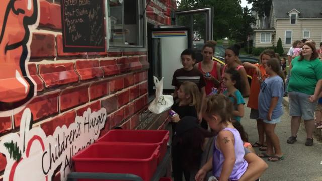 The Children's Hunger Alliance has provided food trucks for several communities this summer as part of a program to provide nutritious meals for kids.