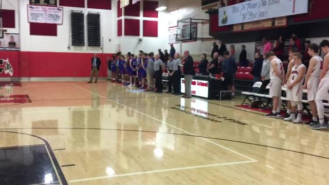 Holy Cross principal Mike Holtz gives a pregame speech in honor of Clay Eifert, a Holy Cross coach, administrator and former principal who died Feb. 9.