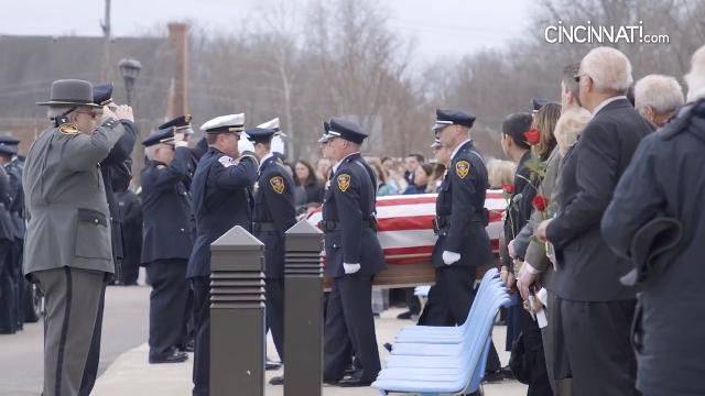 Westerville Police line up and escort the casket of Westerville Police officers Anthony Morelli and Eric Joering outside of St. Paul Catholic Church after funeral services in Westerville, Ohio on Friday, Feb. 16, 2018.