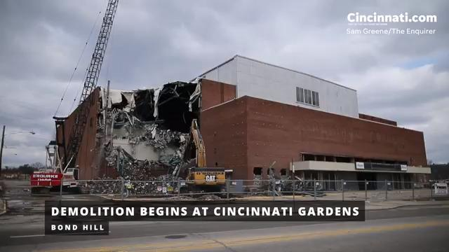 Crews work to demolish the Cincinnati Gardens building on Wednesday afternoon. With a seating capacity of 11,000, the Cincinnati Gardens was once the seventh-biggest indoor stadium when it opened in 1949.