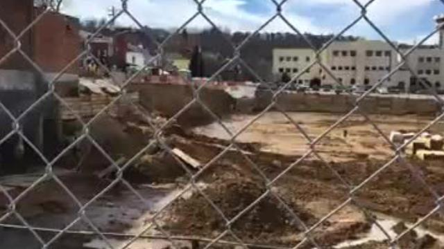 A giant hole grabs attention on Main Street in Covington.