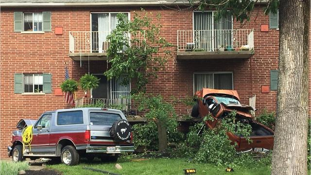 A truck crashed into two parked cars and an apartment building Monday at Boudinot Avenue and Werk Road in Westwood. A passenger in the truck was killed.