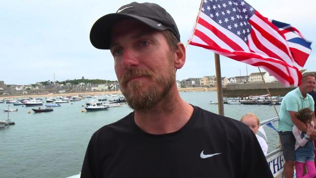 Bryce Carlson lands in England after becoming the first American to row solo and unassisted across the North Atlantic.