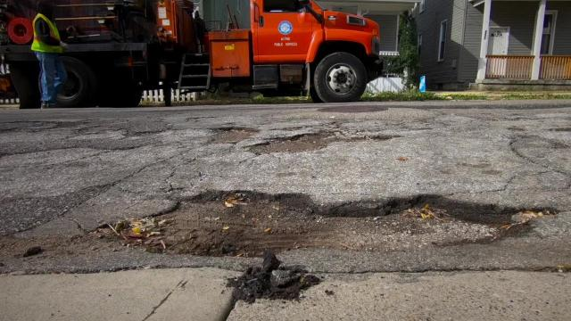 Cincinnati crews repair thousands of potholes every year. Larger potholes are fixed with a mix of liquid tar and asphalt. This time-lapse video shows the process.