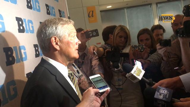 """""""Don't read into it, please,"""" coach Kirk Ferentz asked reporters at the Big Ten media days Monday. The competition between sophomore Nathan Stanley and junior Tyler Wiegers, he says, isn't settled yet."""