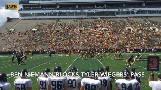 Ben Niemann blocks Tyler Wiegers' pass during Iowa's Kids Day open practice