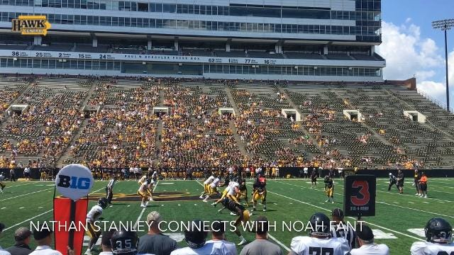 Nathan Stanley connects with Noah Fant during Iowa's Kids Day open practice