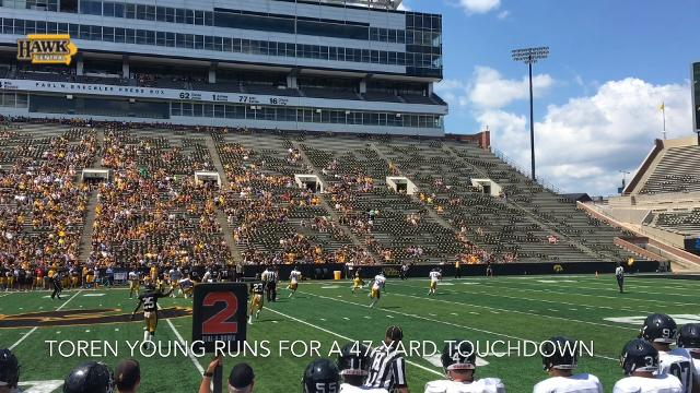 Toren Young runs for a 47-yard touchdown at Iowa's Kids Day open practice