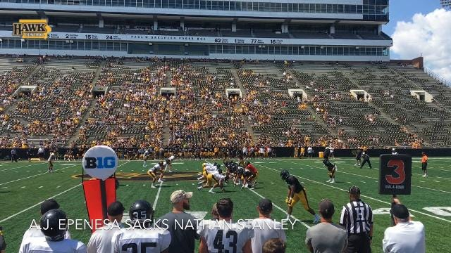 A.J. Epenesa sacks Nathan Stanley during Iowa's Kids Day open practice