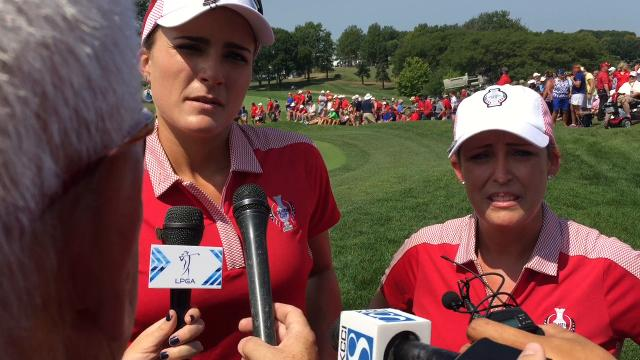 Lexi Thompson and Cristie Kerr won the final two holes to salvage a halve in their opening Solheim Cup match on Friday.