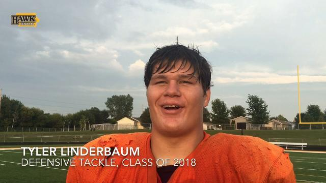 What was Iowa recruit Tyler Linderbaum's earliest memory of the Hawkeyes?