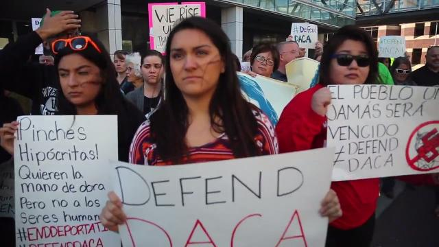 More than 100 attend a rally supporting immigration reform in downtown Des Moines following the Trump administration's DACA announcement Tuesday.
