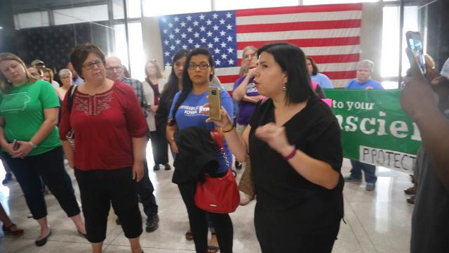 Protesters confront Sen. Joni Ernst staff after the Trump administration's DACA announcement.