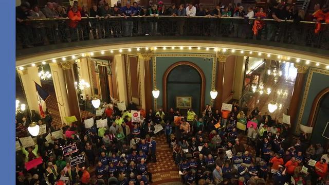 How many Iowans are affected by the state's change to overtime pay rules?